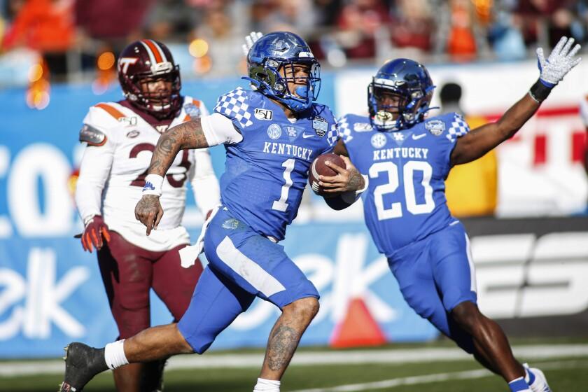 Kentucky quarterback Lynn Bowden Jr. (1) rushes for a 61-yard touchdown against Virginia Tech in the Belk Bowl.