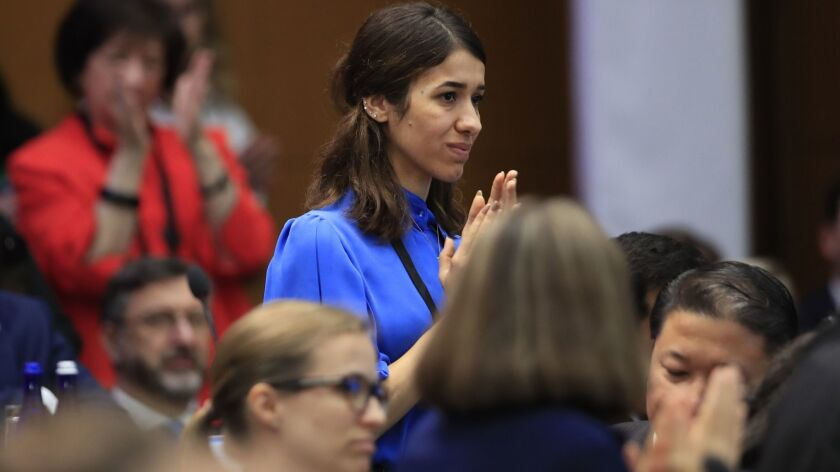 Nadia Murad is recognized by Vice President Mike Pence during his speech at the State Department in July.