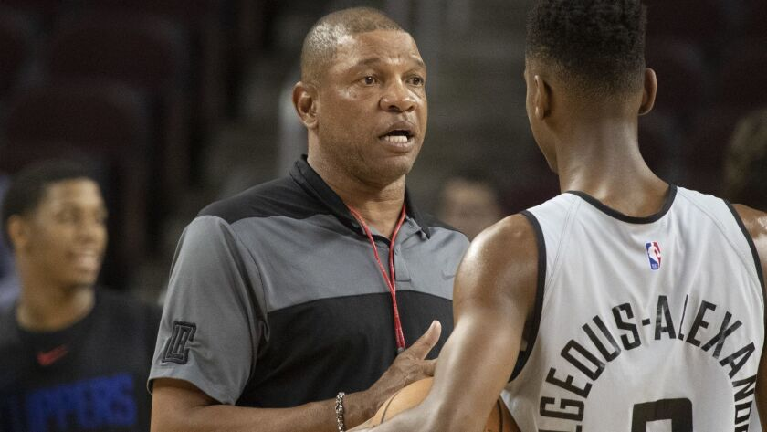 LOS ANGELES, CALIF. -- MONDAY, OCTOBER 8, 2018: L.A. Clippers coach Doc Rivers coaches point guard S
