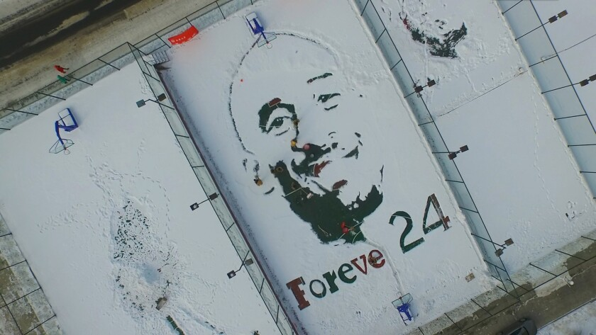 Students draw a big portrait of NBA player Kobe Bryant with snow at a basketball court in Beihua University in Jilin City. Arts academy students used shovels and other tools draw a big snow portrait of Kobe Bryant to remember his career in NBA at a basketball court in Beihua University.