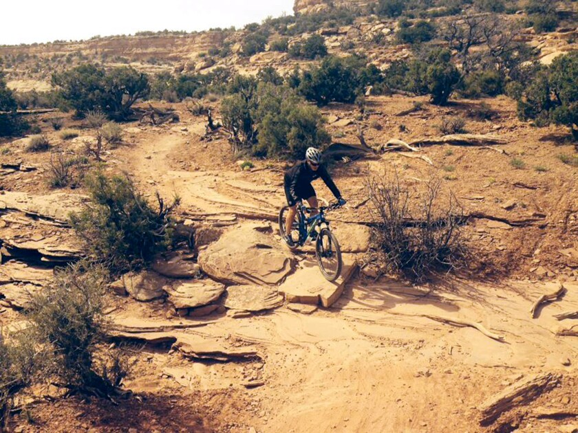 Chris, just three months before a total hip replacement, bikes in Utah.