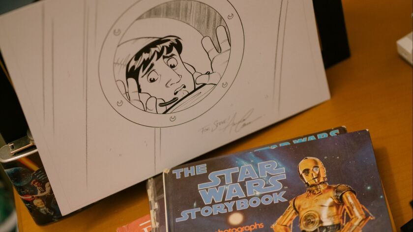 BURBANK, CALIF. - MARCH 29: Original artwork and a Star Wars book sit on a shelf in Big Bang Theory