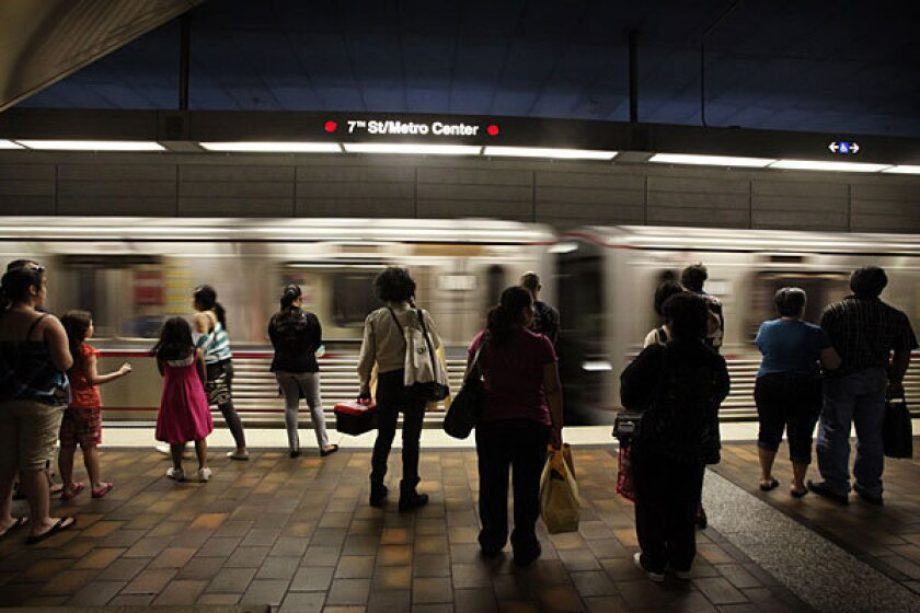 Subway passengers wait at a station in downtown Los Angeles.
