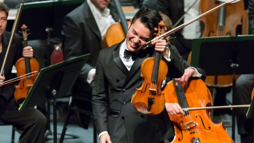Violinist Ray Chen plays with the Bamberg Symphony, conducted by Christoph Eschenbach, during a rece