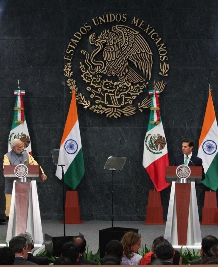 The Prime Minister of India Narendra Modi (L) speaks with the Mexican President Enrique Peña Nieto (R) prior a joint statement at Los Pinos presidencial house in Mexico City, Mexico, 08 June 2016. Modi is on a one day working visit to Mexico, where he will meet with Mexican President Enrique Pena Nieto, with whom he will discuss strengthening commerce, investments and bilateral cooperation. EPA/MARIO GUZMAN