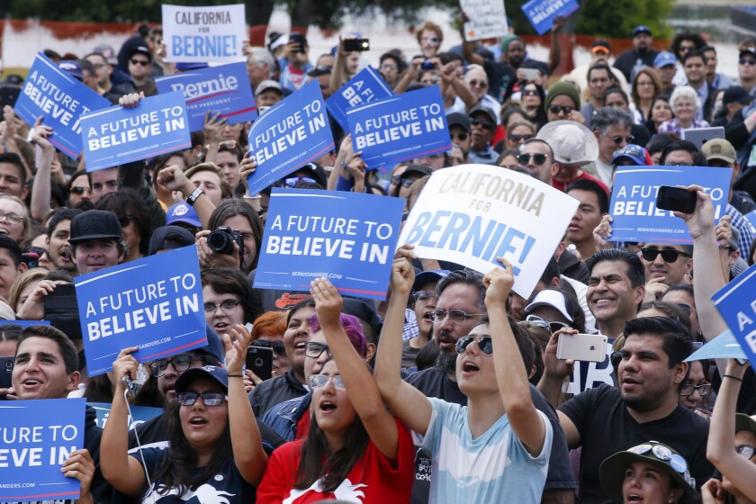 Democratic presidential candidate Bernie Sanders gets a round of applause during a rally at Lincoln Park in East Los Angeles.