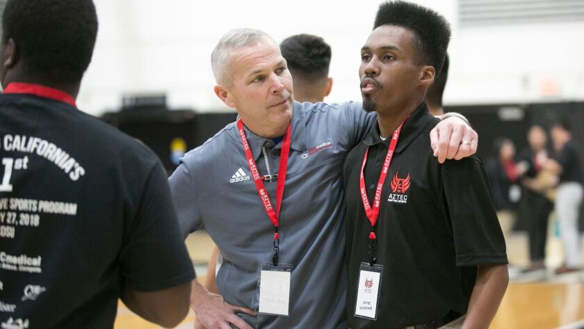 Keith Jones of ABC Medical, left, talks with Ahkeel Whitehead of Aztec Adaptive Sports during a demonstration of adaptive sports at SDSU's Peterson Gym on Saturday.