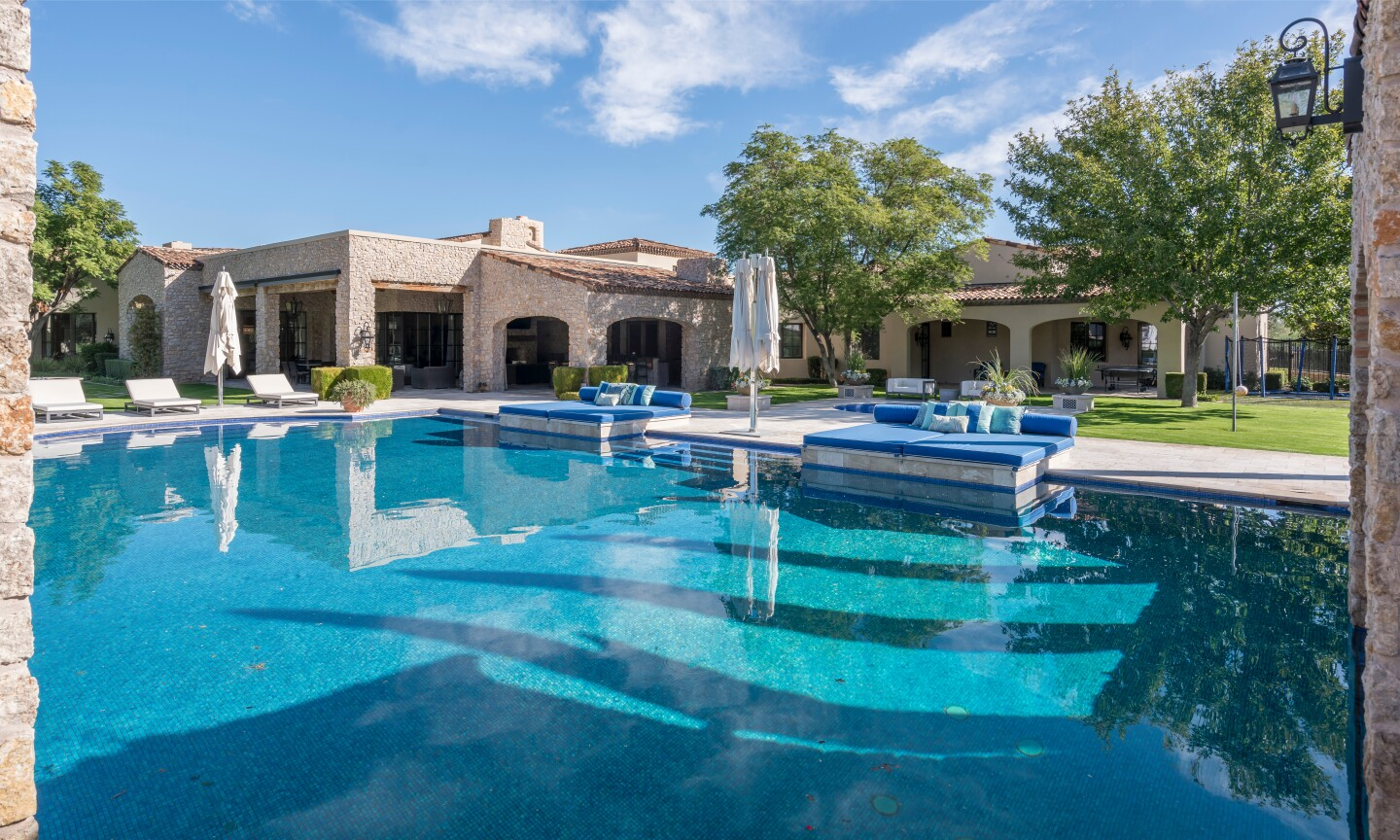 The five-acre estate holds a main house, guesthouse, Suns-themed basketball court, swimming pool, spa and grotto.