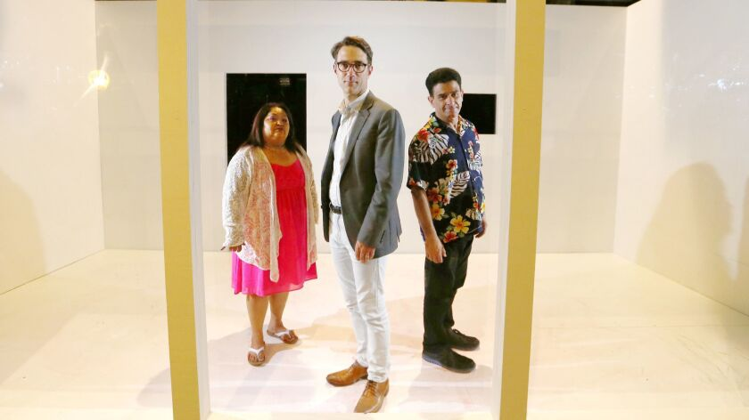 """Director Jeff Janisheski, center, and Rising Scholars co-founder Irene Sotelo and actor John Pizzini are part of Long Beach Opera's production of """"In the Penal Colony."""""""