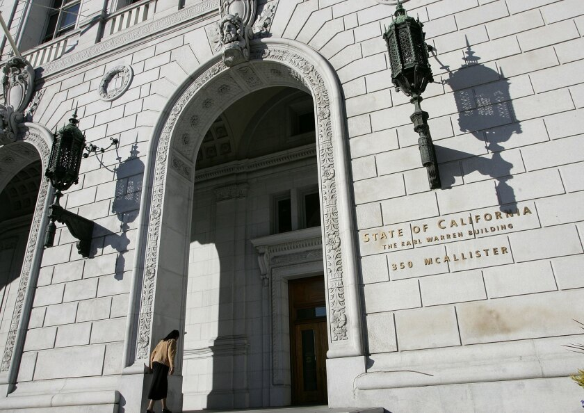 A woman walks into the headquarters of the California Supreme Court