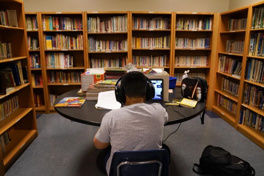 LAUSD student attends an online class