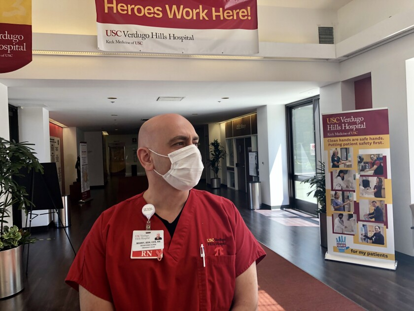 Verdugo Hills Hospital RN Manny Khodadadi says COVID surge has hit the ER.