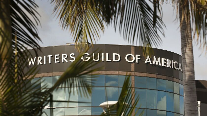 The Writers Guild of America is fighting talent agencies over practices that the guild believes allow agents to prosper while neglecting client interests.