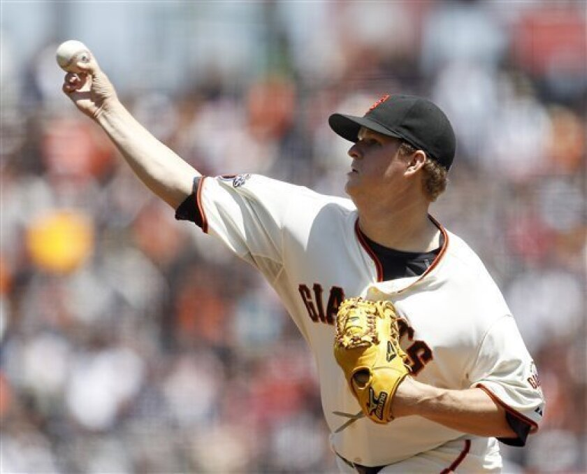 San Francisco Giants starting pitcher Matt Cain throws against the Washington Nationals during the first inning of a baseball game, Wednesday, June 8, 2011, in San Francisco. (AP Photo/Tony Avelar)