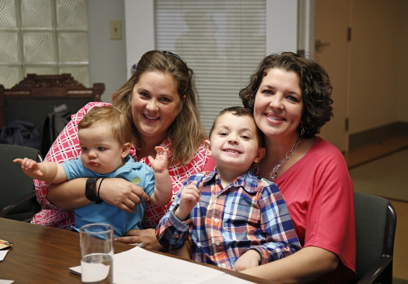 Supreme Court gay marriage plaintiffs Pam Yorksmith, left, and her spouse Nicole Yorksmith, along with their children, Grayden and Orion.
