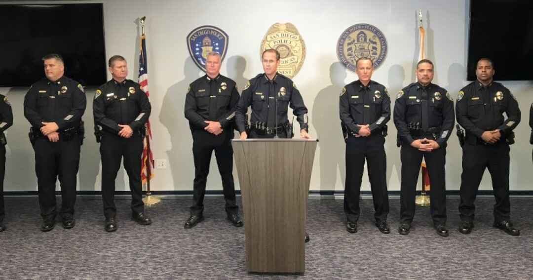 San Diego police Chief David Nisleit, flanked by his command staff, speaks at a news conference.