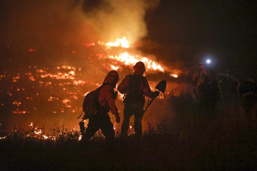 Firefighters battle the Lilac Fire in 2017.