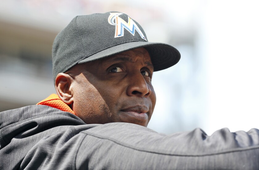 Miami hitting coach Barry Bonds stands in the dugout during a game against Washington on May 15.