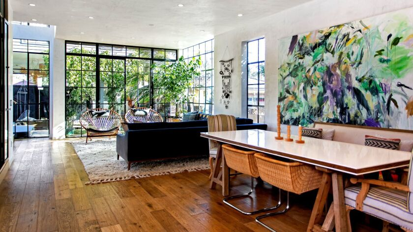 Custom steel-framed windows set the stage for this bohemian-vibe contemporary designed by Kim Gordon