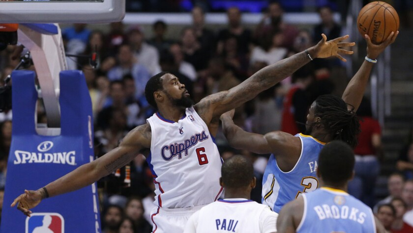 Clippers center DeAndre Jordan tries to block a shot by Denver Nuggets forward Kenneth Faried during a game at Staples Center in April.
