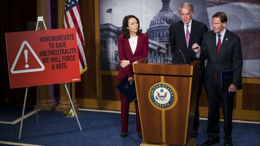 Sen. Richard Blumenthal (D-Conn.), right, speaks during a May 9 news conference on a Senate petition to force a vote to restore net neutrality regulations. With him are Sens. Maria Cantwell (D-Wash.) and Ed Markey (D-Mass.).