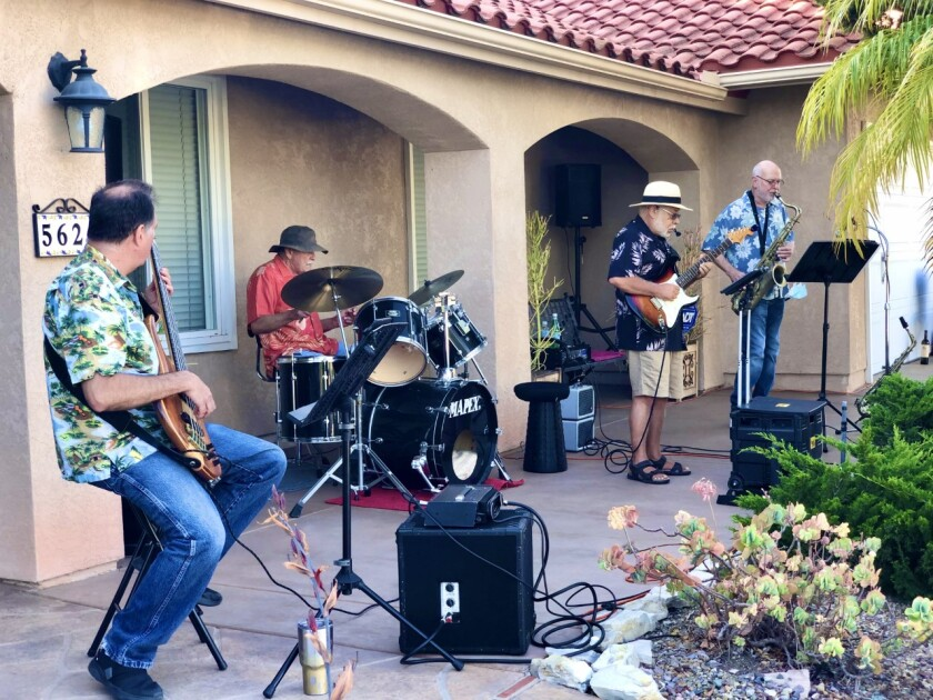 Musicians, from left, Phil Marcus, Jack Hoffman, Roy Jenkins and Greg Pardue continue front porch University City jazz jams.