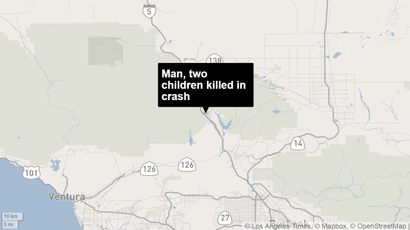 A father and his two children died after their car plowed into the back of a parked big rig.