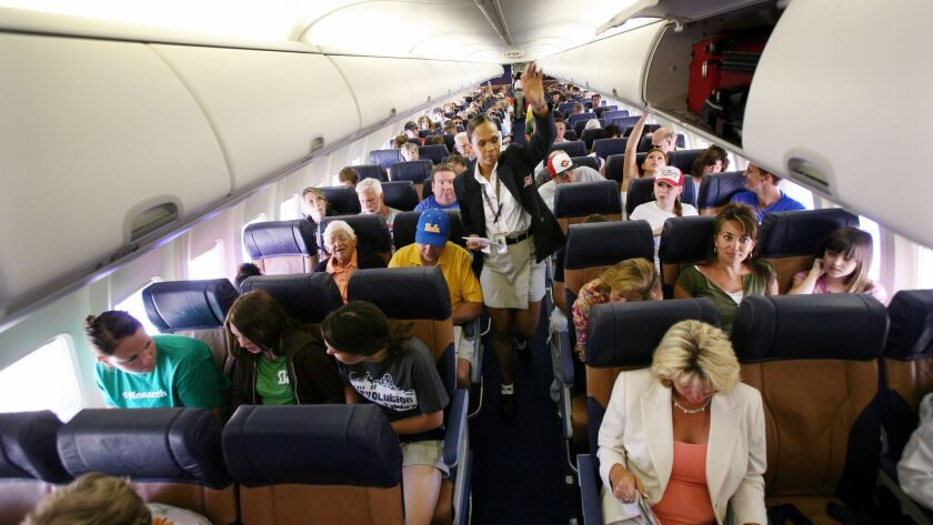 SAN DIEGO, CA - JULY 10: Passengers sit in their assigned seats before take-off July 10, 2006 at Sa