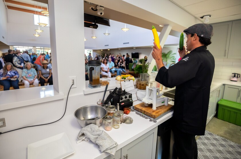 Chef Matthew Purnell puts on a cooking demonstration at the dedication ceremony for the City of Oceanside's Green Oceanside Kitchen at the El Corazon Senior Center in June 2019.