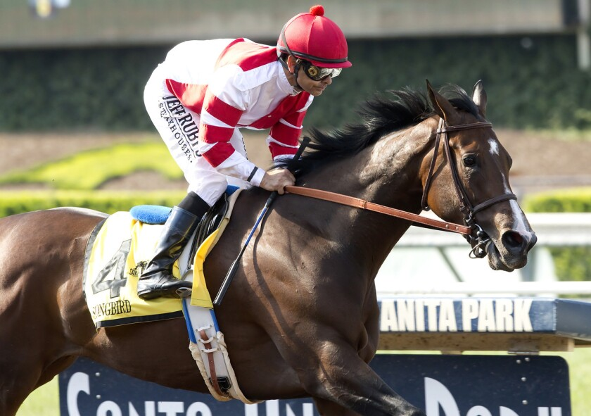 Fox Hill Farms' Songbird and jockey Mike Smith cruise to an easy victory in the Grade II, $200,000 Summertime Oaks at Santa Anita on June 18.