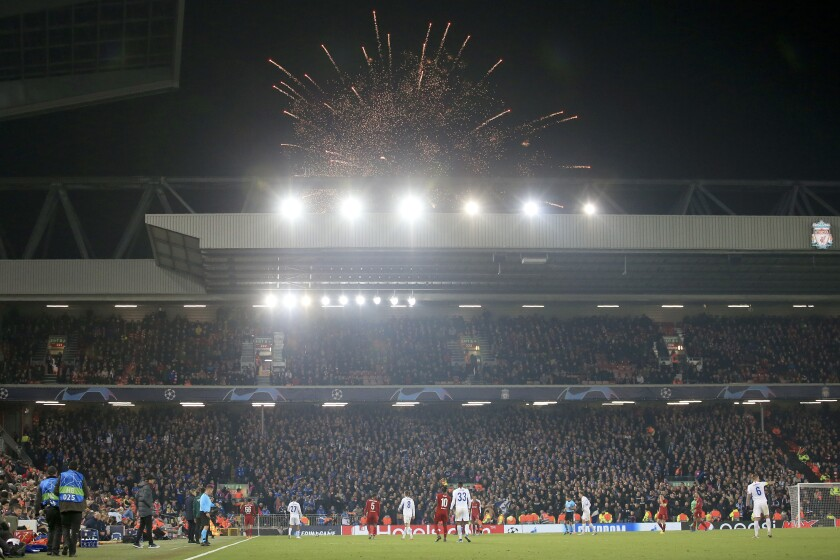 Guy Fawkes Night fireworks go off outside the stadium during the Champions League group E soccer match between Liverpool and Genk at Anfield Stadium, Liverpool, England, Tuesday, Nov. 5, 2019. (AP Photo/Jon Super)