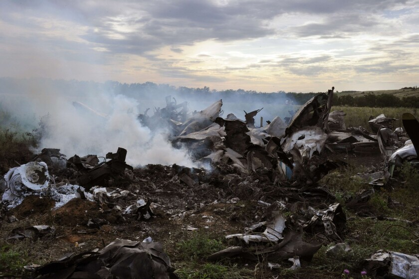 The wreckage of a Ukrainian AN-26 military transport plane after it was shot down July 14 by a missile in the Luhansk region. Ukraine has accused Russia of this earlier incident and the downing July 16 of a Ukrainian Su-24 jet.