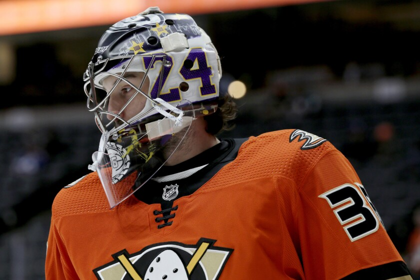 Ducks goalie John Gibson wears a mask honoring the life of Lakers legend Kobe Bryant during a game against the Lightning on Jan. 31.