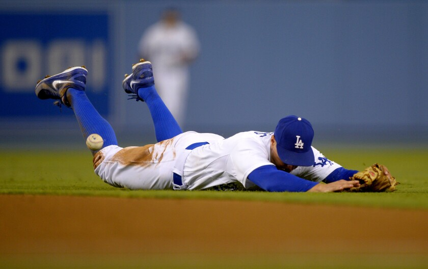 Dodgers second baseman Mark Ellis can't get to a ball hit for a single by Arizona Diamondbacks' Josh Wilson during the ninth inning.