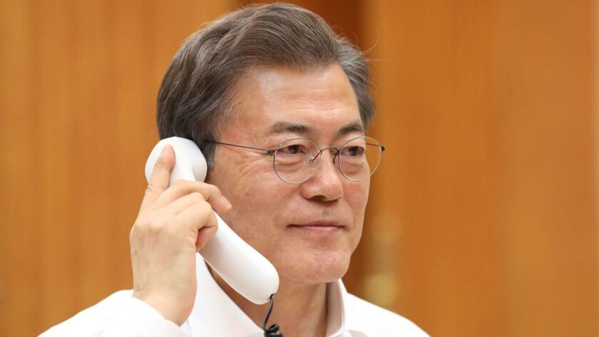 In this image provided by South Korea's presidential Blue House, President Moon Jae-in talks with President Trump on Jan. 4, 2018.