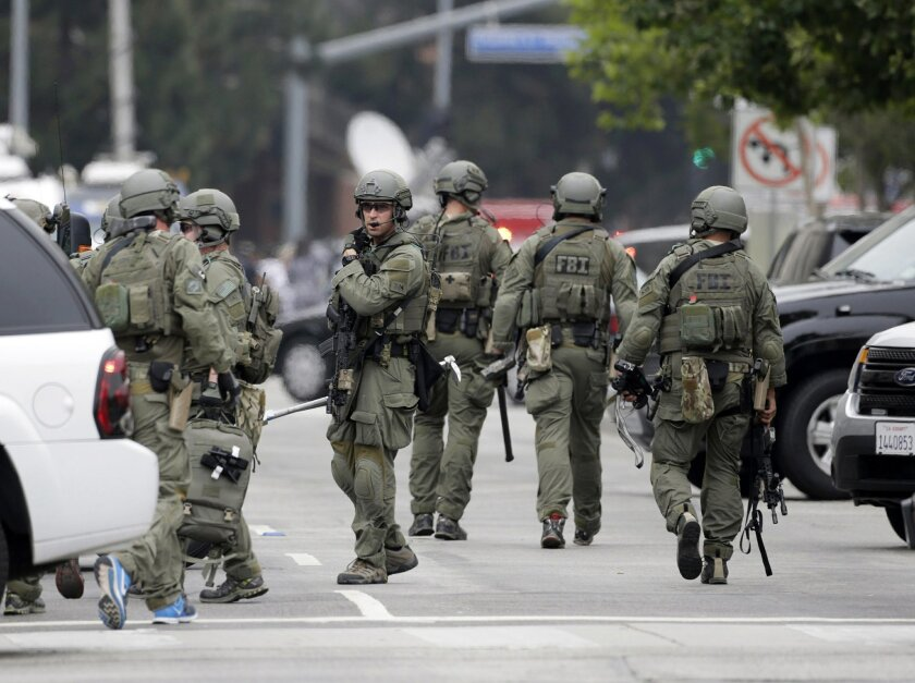 An FBI SWAT team arrives at the scene of a fatal shooting at the University of California, Los Angeles, Wednesday, June 1, 2016, in Los Angeles. (AP Photo/Nick Ut)