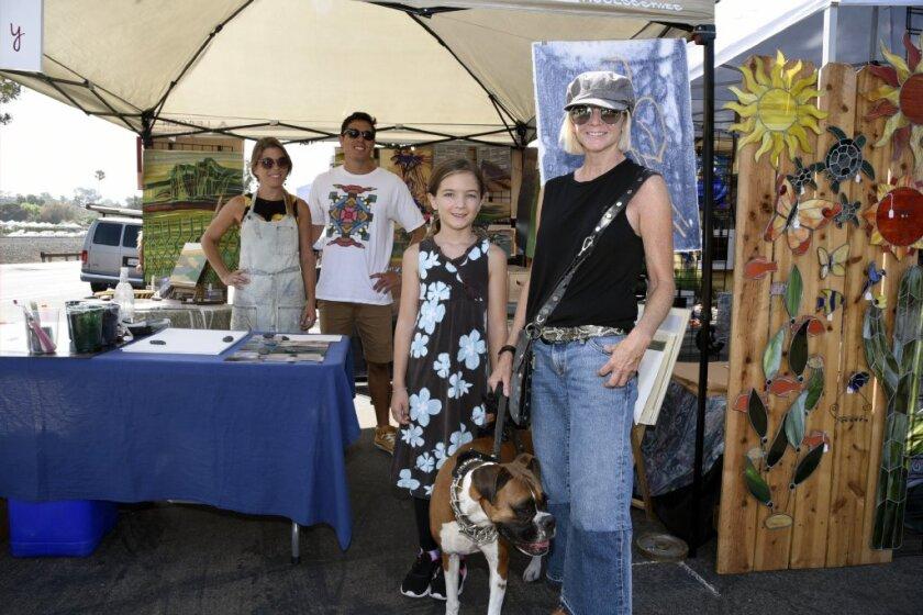 At last year's LeucadiART Walk event: Wallpaper artist Ruby Geisler, Matteo Bovio, Hanna Hanna and daughter Eden, with Finnegan