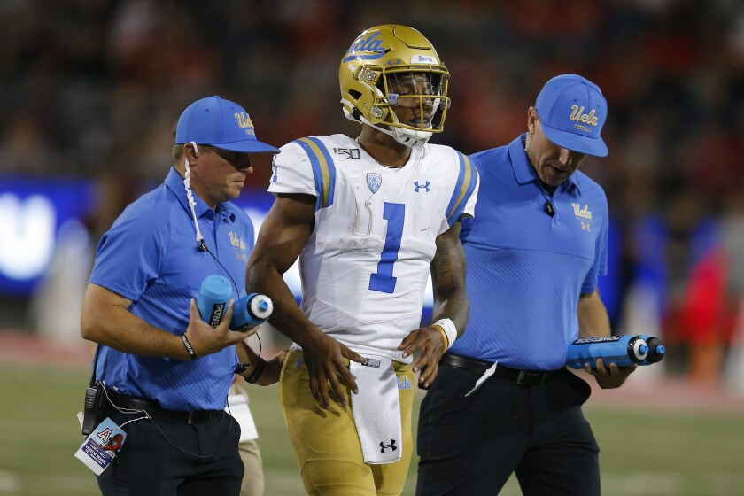 UCLA quarterback Dorian Thompson-Robinson leaves the field after suffering an apparent ankle injury in the third quarter.