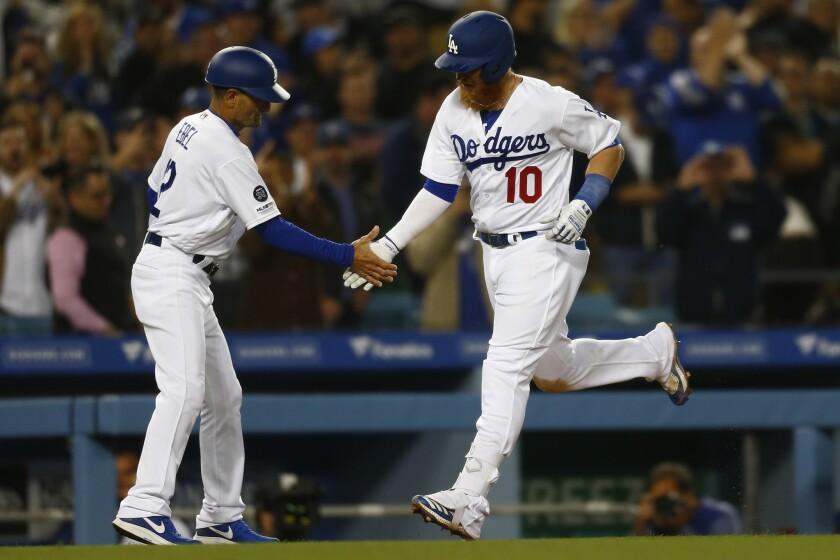 LOS ANGELES, CALIF. - MAY 08: Los Angeles Dodgers third base coach Dino Ebel (12) congratulates thir