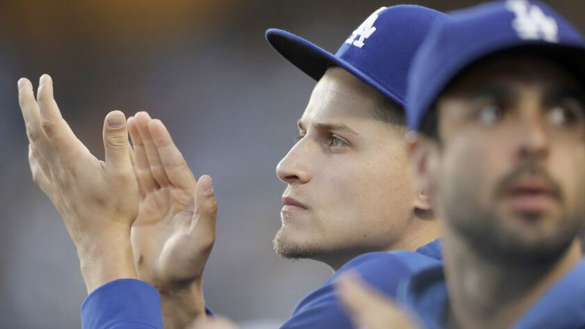 LOS ANGELES, CALIF. - JUNE 19, 2019. Dodgers shortstop Corey Seager applauds his team from the dugou