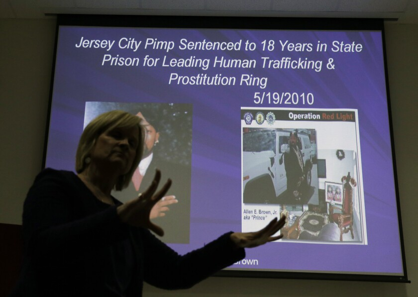 Kathleen Friess gives a presentation on human trafficking in Hamilton Township, N.J., for hotel and nightclub employees. Officials trained legions of law enforcement personnel, hospitality workers, high school students and airport employees to watch for signs of prostitution before the Sunday football game, when hundreds of thousands of people were expected to descend on New Jersey.