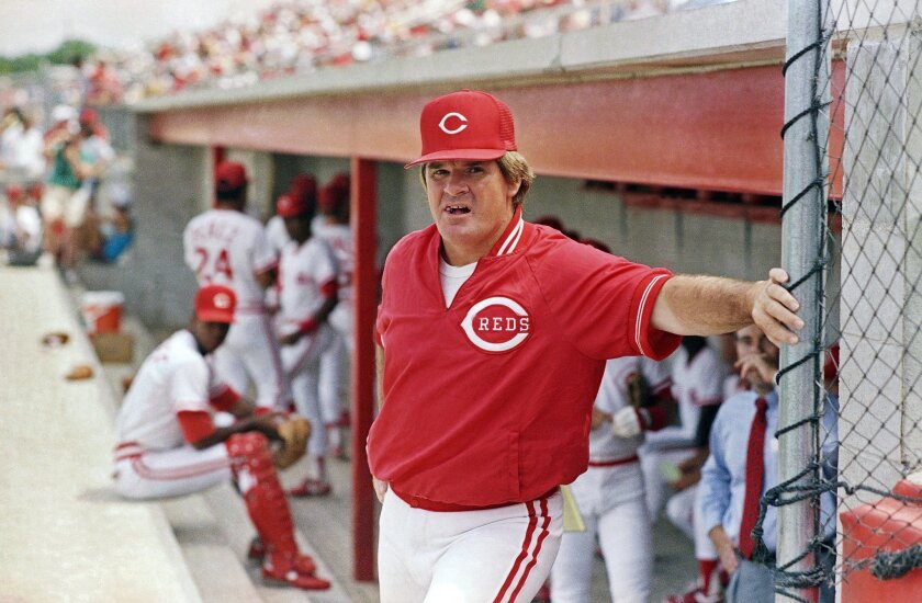 FILE - In this March 22, 1989, file photo, Cincinnati Reds' manager Pete Rose leans against the dugout fence before the start of baseball game in Plant City, Fla. The all-time hits king is going to manage one game this month for the Bridgeport Bluefish in the independent Atlantic League. The 73-year-old Rose will run the Connecticut team on June 16 when they host the Lancaster Barnstormers. (AP Photo/John Swart, File)