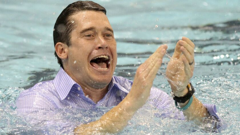 FILE - In this March 26, 2011, file photo, California head coach Dave Durden celebrates after winnin