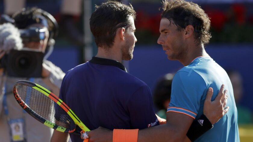 Austria's Dominic Thiem, center, speaks with Spain's Rafael Nadal after defeating him during a semif