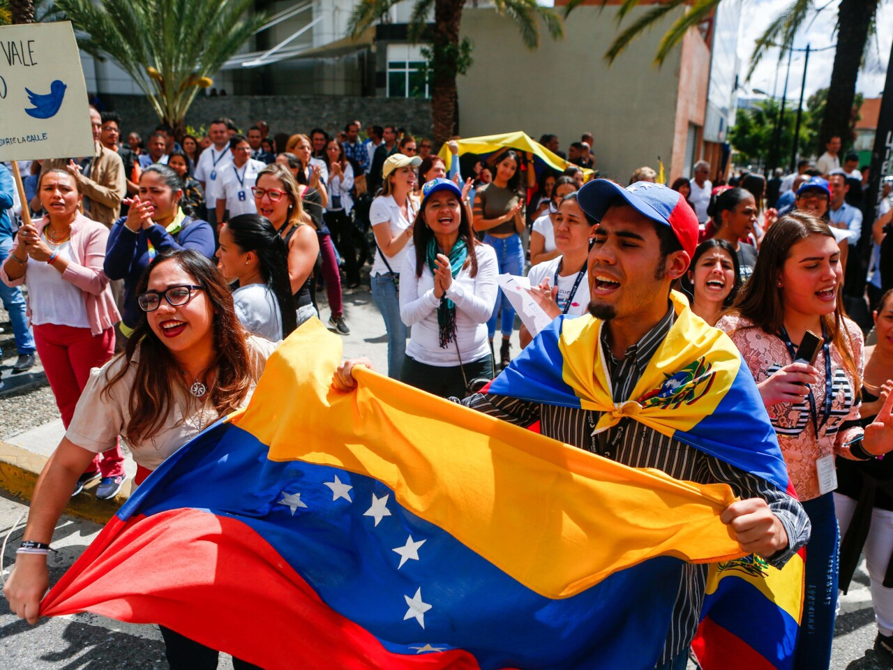 Venezuelan opposition protesters participate in a demonstration to demand the end of the crisis and in support of the interim presidency of Juan Guaido, in Caracas.