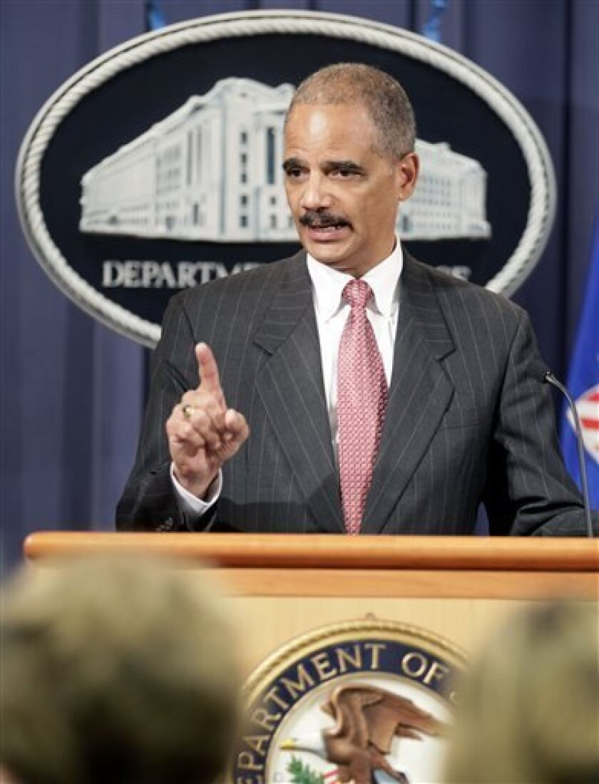 This Oct. 4, 2010 file photo shows Attorney General Eric Holder speaking during a news conference at the Justice Department in Washington. Holder is calling for major changes to the nation's criminal justice system that would scale back the use of harsh prison sentences for certain drug-related crimes, divert people convicted of low-level offenses to drug treatment and community service programs and expand a prison program to allow for release of some elderly, non-violent offenders. (AP Photo/C