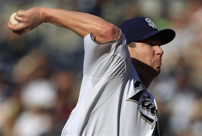 San Diego Padres starting pitcher Dustin Moseley delivers against the Atlanta Braves in the first inning of a baseball game on Saturday, June 25, 2011, in San Diego. (AP Photo/Lenny Ignelzi)