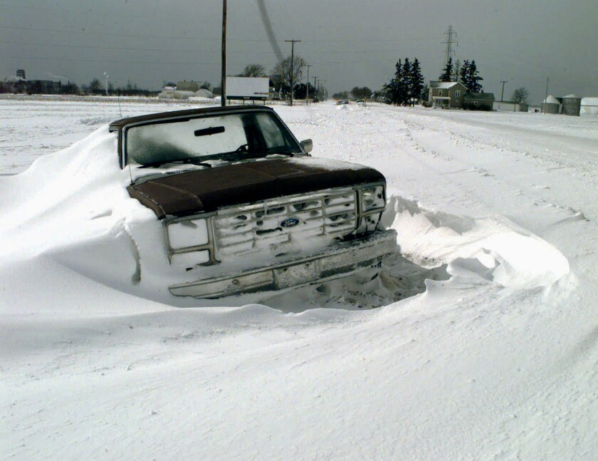 "In an image reminiscent of Ervin Krause's short story ""The Quick and the Dead,"" a truck sits abandoned in a snowdrift west of South Bend, Ind., after a 1998 storm. Krause is one of the writers portrayed in a new multimedia project and e-book, ""Lost Writers of the Plains."""