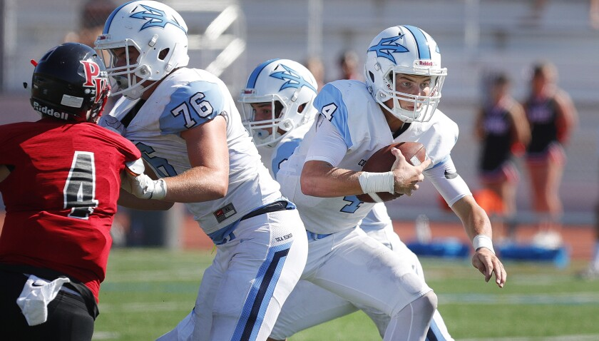 Corona del Mar quarterback Ethan Garbers carries the ball against Palos Verdes on Friday.