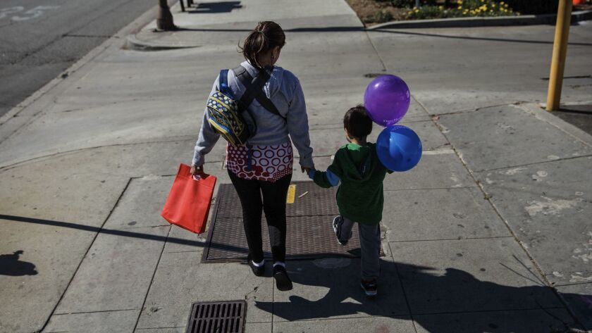 """Veronica Coban, 35, walking with her son, 5-year-old Jaden. """"I haven't been out in almost a week,"""" Coban said. """"I've been afraid to come out."""" The other day my friend said ICE came knocking at her door. She didn't open it but that made me anxious."""""""